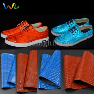 UV embossed reflective leather