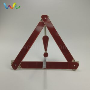 reflective triangle sign on the rear of a vehicle